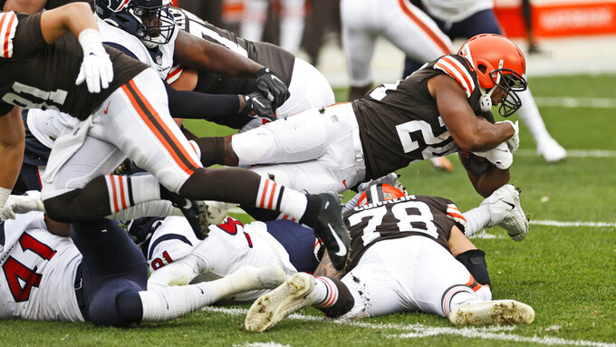 Cleveland Browns running back Nick Chubb dives over players during the first half of an NFL football game against the Houston Texans, Sunday, Nov. 15, 2020, in Cleveland. (AP Photo/Ron Schwane)