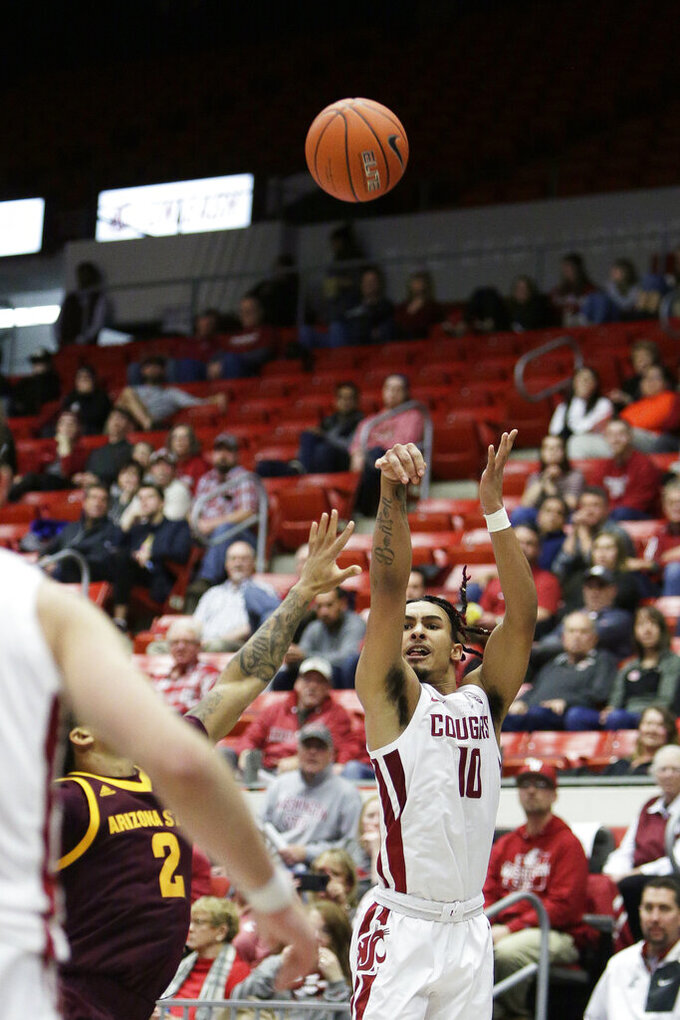 Washington State guard Isaac Bonton (10) shoots next to Arizona State guard Rob Edwards (2) during the second half of an NCAA college basketball game in Pullman, Wash., Wednesday, Jan. 29, 2020. Washington State won 67-65. (AP Photo/Young Kwak)
