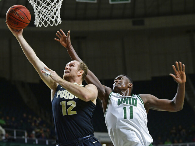 Purdue forward Evan Boudreaux goes to the basket against Ohio forward Slyvester Ogbonda during the first half of an NCAA college basketball game, Tuesday, Dec. 17, 2019, in Athens, Ohio. (AP Photo/David Dermer)