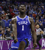FILE - In this March 15, 2019, file photo, Duke's Zion Williamson (1) reacts after a dunk against North Carolina during the second half of an NCAA college basketball game in the Atlantic Coast Conference tournament, in Charlotte, N.C. Williamson was named The Associated Press Player of the Year, Friday, April 5, 2019. (AP Photo/Nell Redmond, File)