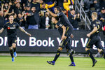Los Angeles FC midfielder Eduard Atuesta, second from left, celebrates his goal with forward Carlos Vela, second from right, during the first half of the team's MLS soccer Western Conference final against the Seattle Sounders, Tuesday, Oct. 29, 2019, in Los Angeles. (AP Photo/Ringo H.W. Chiu)