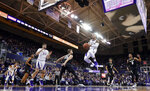 Washington guard David Crisp, center, goes to the basket during the first half of an NCAA college basketball game against Colorado, Saturday, Feb. 23, 2019, in Seattle. (AP Photo/Ted S. Warren)