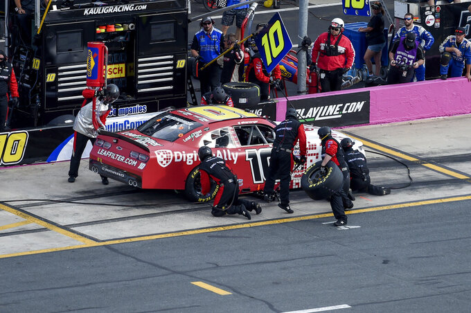 AJ Allmendinger (10) makes a pit stop during a NASCAR Xfinity Series auto race at Charlotte Motor Speedway, Saturday, Sept. 28, 2019, in Concord, N.C. (AP Photo/Mike McCarn)
