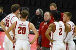 Wisconsin head coach Greg Gard talks to his players during the first half of an NCAA college basketball game against Wisconsin-Green Bay Tuesday, Dec. 1, 2020, in Madison, Wis. (AP Photo/Morry Gash)