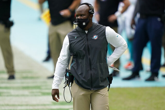 Miami Dolphins head coach Brian Flores walks the sidelines during the first half of an NFL football game against the Seattle Seahawks, Sunday, Oct. 4, 2020, in Miami Gardens, Fla. (AP Photo/Lynne Sladky)
