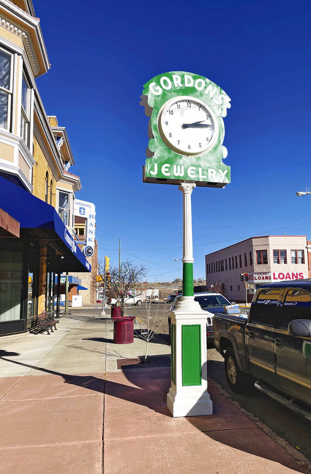 ADVANCE FOR PUBLICATION ON SUNDAY, JAN. 17, AND THEREAFTER - This undated image shows a piece of Las Vegas' history, the Gordon's Jewelry electric clock, in its original location near the intersection of Douglas Avenue and Sixth Street in Las Vegas, New Mexico. The clock's restoration was started by Bob Miser before he died in 2020. The project was completed by the Las Vegas New Mexico Community Foundation. (Phil Scherer/The Daily Optic via AP)