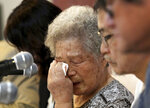 """In this Aug. 14, 2019, photo, Kim Jeong-ju, center, an 88-year-old who is seeking compensation for her forced labor at a Japanese munitions factory in 1945, weeps during a press conference in Seoul, South Korea. """"I lived like a slave there, but (Prime Minister) Abe is acting like he doesn't know,"""" said Kim, during a news conference in Seoul. (AP Photo/Ahn Young-joon)"""