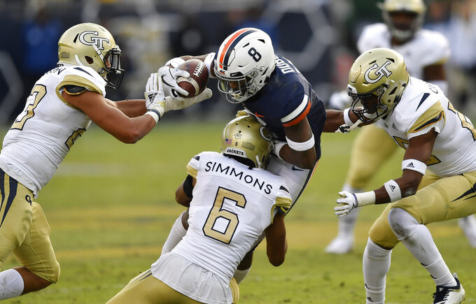Virginia wide receiver Hasise Dubois (8) runs into Georgia Tech defensive back Lamont Simmons (6) during the first half of an NCAA football game, Saturday, Nov. 17, 2018, in Atlanta. (AP Photo/Mike Stewart)