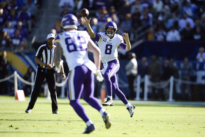 Minnesota Vikings quarterback Kirk Cousins throws a pass intended for tight end Kyle Rudolph (82) during the first half of an NFL football game against the Los Angeles Chargers Sunday, Dec. 15, 2019, in Carson, Calif. (AP Photo/Kelvin Kuo)