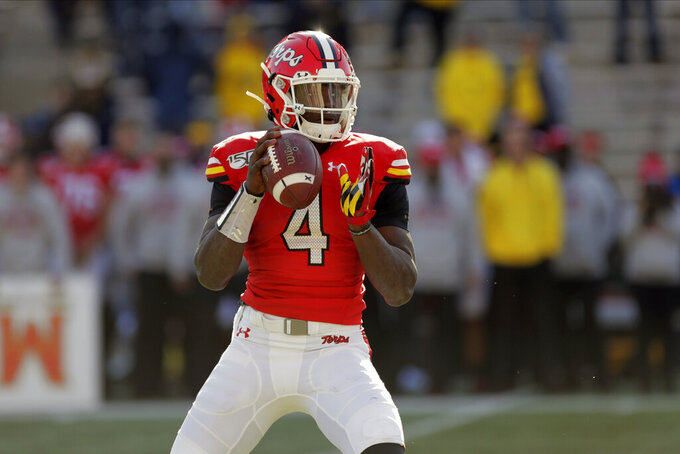 FILE - In this Nov. 2, 2019, file photo, Maryland quarterback Lance LeGendre looks to pass against Michigan during the second half of an NCAA college football game, in College Park, Md. As head coach Michael Locksley enters his second season as the helm, he deals with quarterback Josh Jackson opting out of the 2020 season because of the COVID-19 pandemic and Tyrrell Pigrome has transferred to Western Kentucky. Taulia Tagovailoa, an Alabama transfer, and Legendre, a redshirt freshman, have been competing for the starting spot this fall. (AP Photo/Julio Cortez, File)