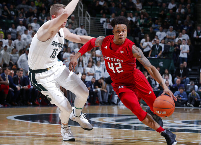 Rutgers' Jacob Young, right, drives against Michigan State's Thomas Kithier during the first half of an NCAA college basketball game, Sunday, Dec. 8, 2019, in East Lansing, Mich. (AP Photo/Al Goldis)