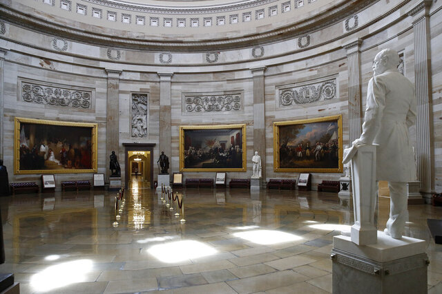 The U.S. Capitol Rotunda sits empty on Capitol Hill in Washington, Monday, March 16, 2020. Congress has shut the Capitol and all Senate and House office buildings to the public until April in reaction to the spread of the coronavirus outbreak. (AP Photo/Patrick Semansky)