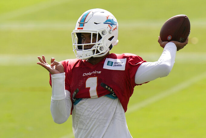 FILE - In this Aug. 25, 2020, file photo, Miami Dolphins quarterback Tua Tagovailoa does drills during practice at the NFL football team's training facility in Davie, Fla. When asked Monday, Oct. 5, 2020, about the Dolphins' quarterback situation, coach Brian Flores paused for eight seconds he answered. That was plenty of time to stir up even more speculation regarding when top draft pick Tagovailoa might make his NFL debut. (AP Photo/Lynne Sladky, File)
