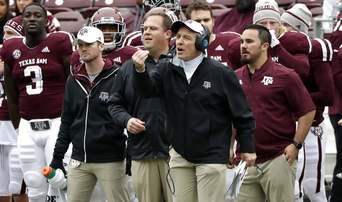 Texas A&M coach Jimbo Fisher yells to the officials during the second half of an NCAA college football game against Mississippi Saturday, Nov. 10, 2018, in College Station, Texas. Texas A&M won 38-24. (AP Photo/David J. Phillip)