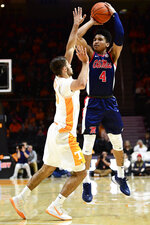 Mississippi guard Breein Tyree (4) shoots over Tennessee guard Santiago Vescovi (25) during an NCAA college basketball game, Tuesday, Jan. 21, 2020 in Knoxville, Tenn. (Calvin Mattheis/Knoxville News Sentinel via AP)