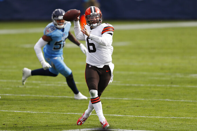 Cleveland Browns quarterback Baker Mayfield (6) throws as he scrambles against the Tennessee Titans in the first half of an NFL football game Sunday, Dec. 6, 2020, in Nashville, Tenn. (AP Photo/Wade Payne)