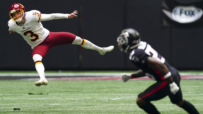 Washington Football Team kicker Dustin Hopkins (3) works against the Atlanta Falcons during the first half of an NFL football game, Sunday, Oct. 3, 2021, in Atlanta. (AP Photo/John Bazemore)