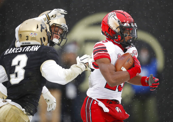 Utah wide receiver Jaylen Dixon, right, runs for a touchdown after pulling in a pass while covered by Colorado defensive backs Derrion Rakestraw, front left, and Dante Wigley in the second half of an NCAA college football game Saturday, Nov. 17, 2018, in Boulder, Colo. Utah won 30-7. (AP Photo/David Zalubowski)
