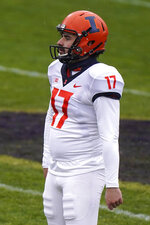 Illinois kicker James McCourt reacts after missing a field goal against Northwestern during the first half of an NCAA college basketball game in Evanston, Ill., Saturday, Dec. 12, 2020. (AP Photo/Nam Y. Huh)