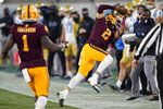 Arizona State wide receiver LV Bunkley-Shelton (2) pulls in a pass for a first down against UCLA during the first half of an NCAA college football game Saturday, Dec. 5, 2020, in Tempe, Ariz. (AP Photo/Matt York)