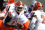 Bowling Green quarterback Darius Wade (6) hands off the ball during the first half of an NCAA college football game against Kansas State Saturday, Sept. 7, 2019, in Manhattan, Kan. (AP Photo/Charlie Riedel)