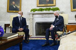 FILE - In this Friday, Aug. 27, 2021 file photo, President Joe Biden meets with Israeli Prime Minister Naftali Bennett in the Oval Office of the White House in Washington. On Friday, Sept. 2, 2021, The Associated Press reported on stories circulating online incorrectly asserting Biden slept during high-level talks with Bennett. But during a 14-minute video taken during the meeting, Biden does not fall asleep. He looks down at his lap several times, including when he's listening and reading from his notepad. (AP Photo/Evan Vucci, File)