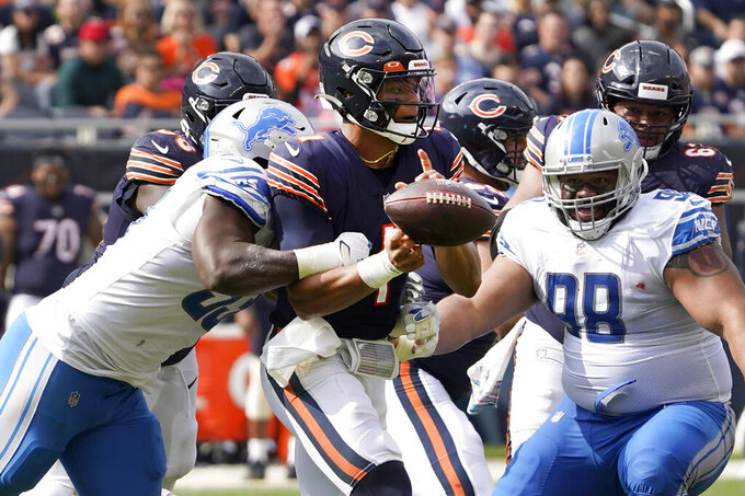 Detroit Lions linebacker Charles Harris strips Chicago Bears quarterback Justin Fields of the ball during the second half of an NFL football game Sunday, Oct. 3, 2021, in Chicago. The Bears won 24-14. (AP Photo/David Banks)
