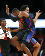 Florida guards Scottie Lewis (23) and Andrew Nembhard (2) celebrate after the team defeated Providence 83-51 in an NCAA college basketball game at Barclays Center, Tuesday, Dec. 17, 2019, in New York. (AP Photo/Michael Owens)