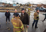 Elmore County Sheriff Bill Franklin talks with first responders on the scene after a heavy storm hit in Wetumpka, Ala., on Saturday, Jan. 19, 2019. The mayor of Wetumpka in central Alabama says a possible tornado has caused significant damage to the city's downtown, with several buildings on the ground after an intense storm passed through the area. (Mickey Welsh/The Montgomery Advertiser via AP)
