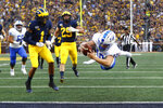 Middle Tennessee quarterback Asher O'Hara dives for a 18-yard touchdown run in the first half of an NCAA college football game against Michigan in Ann Arbor, Mich., Saturday, Aug. 31, 2019. (AP Photo/Paul Sancya)