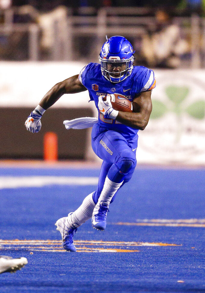 Boise State running back Alexander Mattison (22) runs with the ball against Utah State in the second of an NCAA college football game, Saturday, Nov. 24, 2018, in Boise, Idaho. Boise State won 33-24. (AP Photo/Steve Conner)