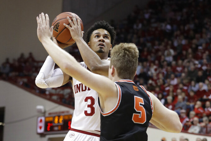 Indiana's Justin Smith (3) goes to the basket against Princeton's Drew Friberg (5) during the first half of an NCAA college basketball game Wednesday, Nov. 20, 2019, in Bloomington, Ind. (AP Photo/Darron Cummings)