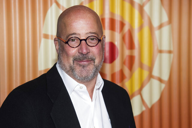 """FILE - Chef and TV personality Andrew Zimmern attends The Charlize Theron Africa Outreach Project fundraiser in New York on Nov. 12, 2019. Zimmern has tips on how to navigate a feast during a global pandemic. Zimmern has teamed up with AARP for a free live streaming cooking demonstration and question-and-answer session Thursday called """"AARP Presents: A Caregivers Thanksgiving."""" The one-hour event will be available AARP's site and Facebook Live. (Photo by Charles Sykes/Invision/AP, File)"""