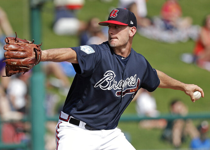 FILE - In this March 4, 2019, file photo, Atlanta Braves' Grant Dayton pitches against the Houston Astros in the sixth inning of a spring baseball exhibition game in Kissimmee, Fla. Dayton is excited to driving north for the resumption of spring training with the Braves. He knows he will not be getting any more salary.