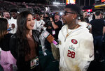 San Francisco 49ers' Jerick McKinnon interviews Mina Kimes during Opening Night for the NFL Super Bowl 54 football game Monday, Jan. 27, 2020, at Marlins Park in Miami. (AP Photo/David J. Phillip)