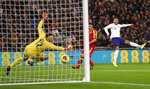 England's Alex Oxlade-Chamberlain, right, scores the opening goal during the Euro 2020 group A qualifying soccer match between England and Montenegro at Wembley stadium in London, Thursday, Nov. 14, 2019. (AP Photo/Kirsty Wigglesworth)