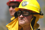 A firefighter watches the Apple Fire in Banning, Calif., Sunday, Aug. 2, 2020. (AP Photo/Ringo H.W. Chiu)
