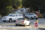 Vehicles do their best to cross the intersection of Camino Pablo and Brookwood Road during a power outage in Orinda, Calif., on Thursday, Oct. 10, 2019. Business continue to be closed due to the recent Pacific Gas and Electric shutdown. The utility company began restoring power to Bay Area residents Thursday, taking the first steps in what could be a days-long process to end an outage that left many homes and businesses in the dark. (Jose Carlos Fajardo/East Bay Times via AP)