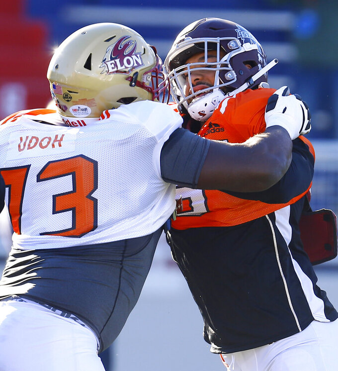 South defensive end Montez Sweat of Mississippi State (9) tries to get around South offensive tackle Oli Udoh of Elon (73) during practice for Saturday's Senior Bowl college football game, Thursday, Jan. 24, 2019, in Mobile, Ala. (AP Photo/Butch Dill)