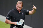 "Las Vegas Raiders head coach Jon Gruden reacts during an NFL football training camp practice Friday, Aug. 21, 2020, in Las Vegas. The excitement over the move to Las Vegas has been tempered a bit by the fact no fans will be allowed at the games because of the coronavirus. Owner Mark Davis has said he won't go to games either until his fans are allowed so the real unveiling might not come until 2021. ""It's crushing,"" Gruden said.(AP Photo/John Locher)"
