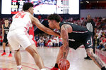 Houston guard Quentin Grimes (24) reaches in against Cincinnati guard Jarron Cumberland, right, during the first half of an NCAA college basketball game Sunday, March 1, 2020, in Houston. (AP Photo/Michael Wyke)
