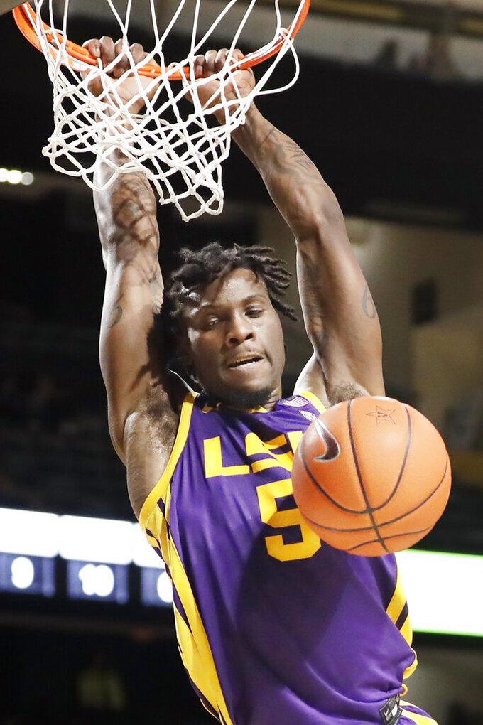 LSU forward Emmitt Williams dunks against Vanderbilt in the first half of an NCAA college basketball game Wednesday, Feb. 5, 2020, in Nashville, Tenn. (AP Photo/Mark Humphrey)