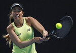 Danielle Collins of the U.S. makes a backhand return to Kazakhstan's Yulia Putintseva during their second round singles match at the Australian Open tennis championship in Melbourne, Australia, Thursday, Jan. 23, 2020. (AP Photo/Andy Wong)