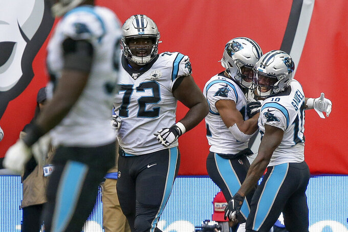 Carolina Panthers wide receiver Curtis Samuel (10) celebrates with wide receiver D.J. Moore (2) after scoring a touchdown against the Tampa Bay Buccaneers during the third quarter of an NFL football game, Sunday, Oct. 13, 2019, at Tottenham Hotspur Stadium in London. (AP Photo/Tim Ireland)