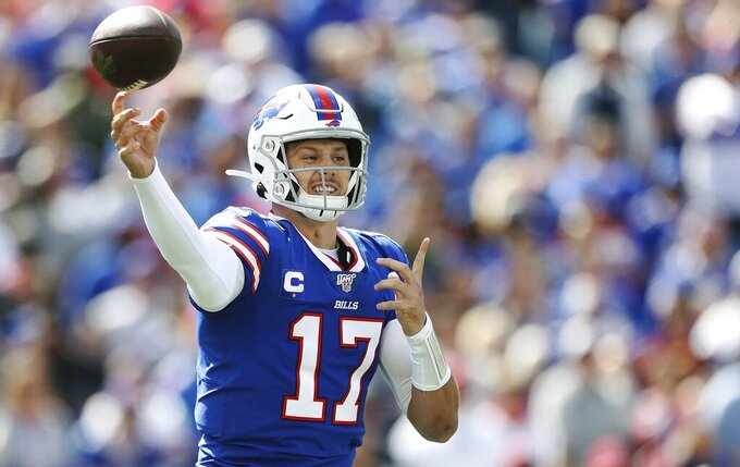 Buffalo Bills quarterback Josh Allen passes against the New England Patriots in the first half of an NFL football game, Sunday, Sept. 29, 2019, in Orchard Park, N.Y. (AP Photo/Ron Schwane)