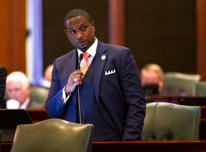 Illinois state Rep. Maurice West, D-Rockford, introduces Senate Bill 825, an election omnibus bill which would change Illinois' 2022 primary election from March 15 to June 28 along with voter access changes, on the floor of the Illinois House of Representatives at the Illinois State Capitol in Springfield, Ill., Monday, May 31, 2021. (Justin L. Fowler/The State Journal-Register via AP)