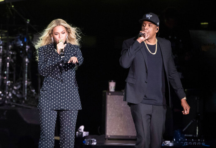 FILE - In this Nov. 4, 2016 file photo, Beyonce and Jay-Z perform during a Democratic presidential candidate Hillary Clinton campaign rally in Cleveland. During a performance on Monday, Aug. 13, 2018, Beyonce dedicated her performance with husband, Jay Z, to the Queen of Soul drawing a thunderous roar from Aretha Franklin's hometown of Detroit. ( AP Photo/Matt Rourke, File)
