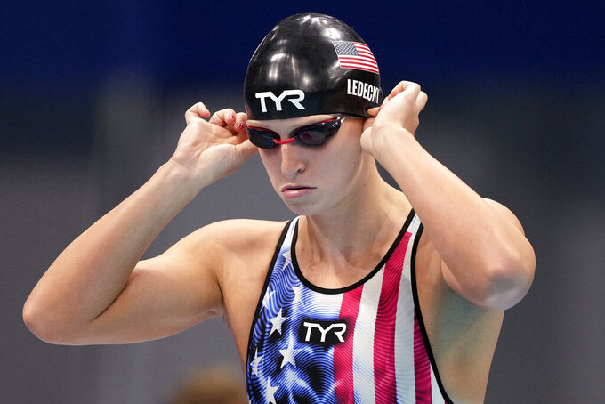 Katie Ledecky of United States prepares for her swim in the women's 200-meter freestyle semifinal at the 2020 Summer Olympics, Tuesday, July 27, 2021, in Tokyo, Japan. (AP Photo/Matthias Schrader)