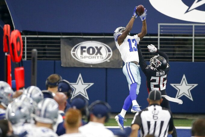 Dallas Cowboys wide receiver Michael Gallup (13) goes up to make a catch for a long gain in front of Atlanta Falcons' Isaiah Oliver (26) in the second half of an NFL football game in Arlington, Texas, Sunday, Sept. 20, 2020. (AP Photo/Ron Jenkins)