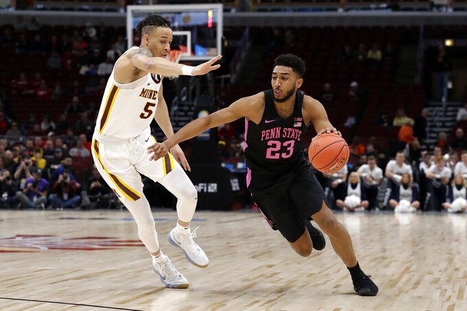 Penn State's Josh Reaves (23) drives against Minnesota's Amir Coffey (5) during the first half of an NCAA college basketball game in the second round of the Big Ten Conference tournament, Thursday, March 14, 2019, in Chicago. (AP Photo/Nam Y. Huh)